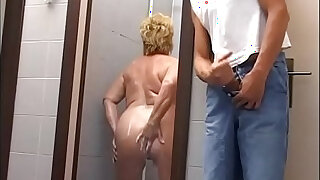 Mature woman attacked and fucked in the gym shower - 20:00